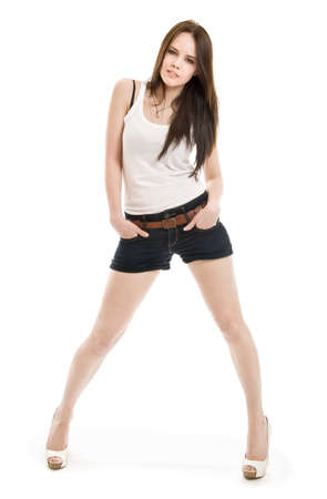 The girl in shorts standing on a white background Stock Photo - 13233500