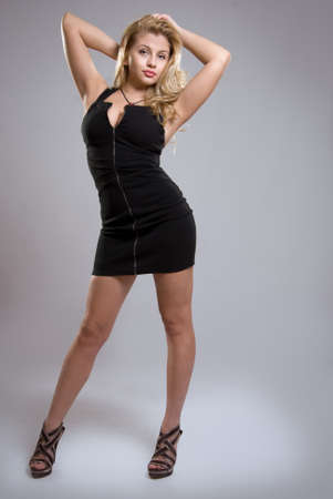 Curvy blonde girl black dress photo