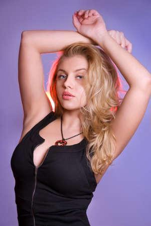 tall and short: Curvy blonde girl black dress Stock Photo