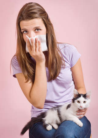 allergic: The girl is allergic to cat
