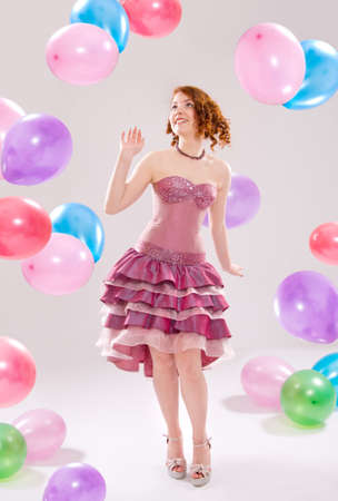 girl in a dress with balloons photo