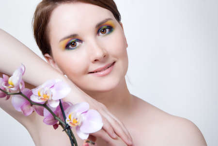 Beautiful girl's face and orchid Stock Photo - 13619273