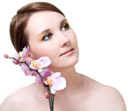 Beautiful girl's face and orchid Stock Photo - 13619279