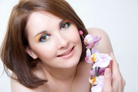 Beautiful girl's face and orchid Stock Photo - 13619291