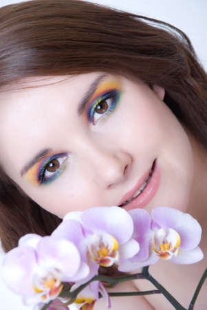Beautiful girl's face and orchid Stock Photo - 13619289
