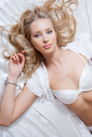 nude blond girl: portrait of young elegant woman in bed