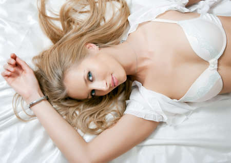 nude girl pretty young: portrait of young elegant woman in bed