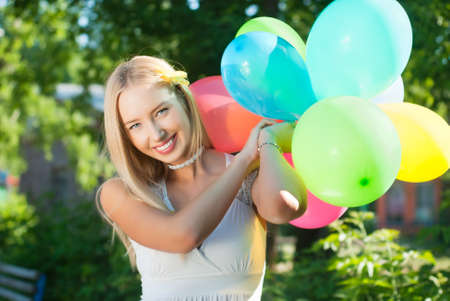 Charming girl with balloons at the festival photo