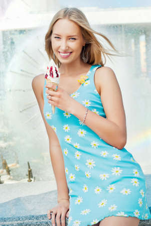 Girl with ice cream at the fountain photo