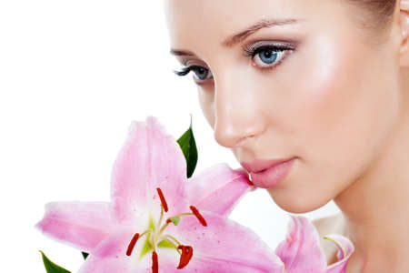 beautiful face: The face of a beautiful girl with a fresh flower lily Stock Photo