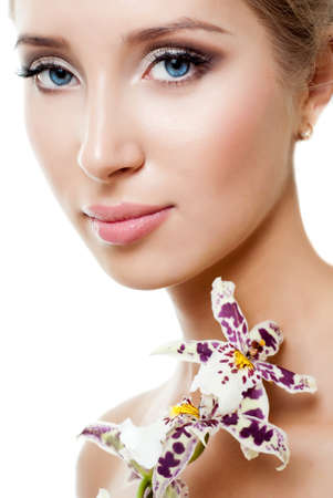 Beautiful young woman with white orchid Stock Photo - 14630275