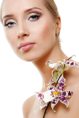 Beautiful young woman with white orchid Stock Photo - 14632950