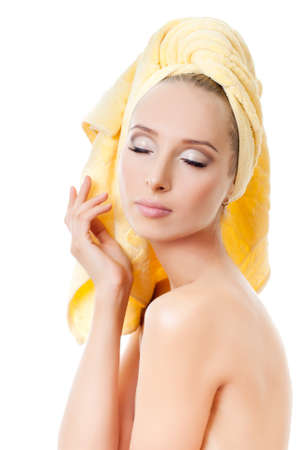 portrait of attractive caucasian smiling woman with towel photo