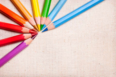 Colored pencils are a pattern on fabric photo