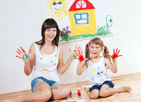 nurser: Woman and child have fun paint colors