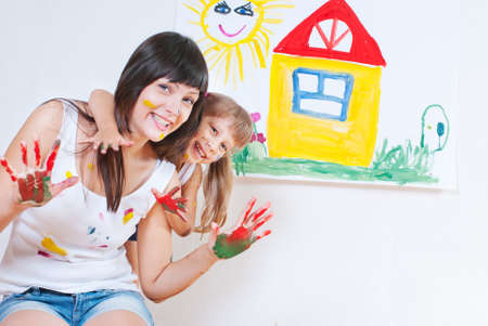 kindergarten teacher: Woman and child have fun paint colors