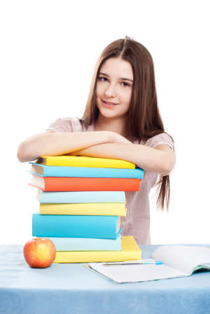 prodigy: The girl child at the table with books on white background