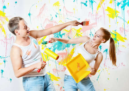 Young couple making repairs in the paint photo