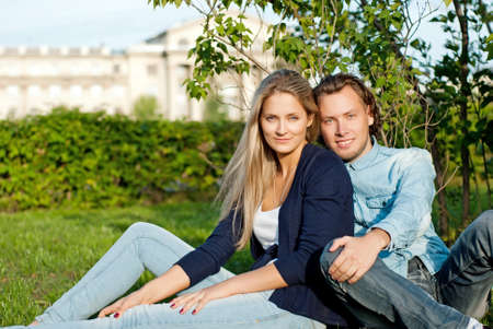 couple on a walk, sit on the grass in the park Stock Photo - 15278085