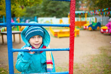 the girl on the playground, autumn photo