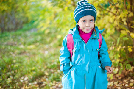 Girl walking in autumn forest photo