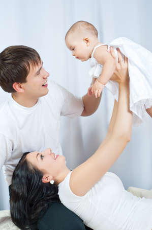 Happy family playing with a baby  at home Stock Photo - 15734257