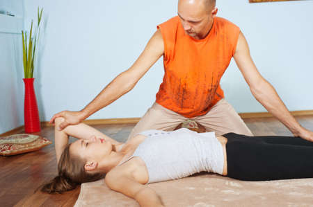 Masseur makes Thai massage girl photo