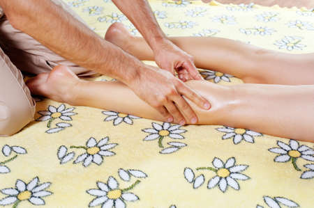 Leg massage with massage oil in the cabin Stock Photo - 15659664