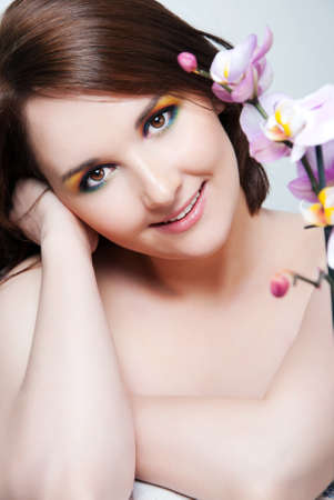 Beautiful girl's face and orchid Stock Photo - 15734248