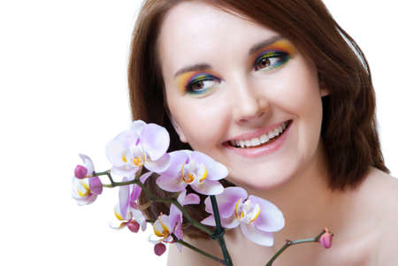 Beautiful girl's face and orchid photo