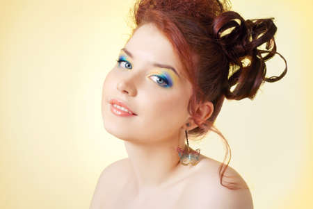 A girl with bright makeup on a yellow background Stock Photo - 15734247