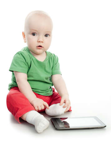 Baby play with the tablet computer Stock Photo - 15956163