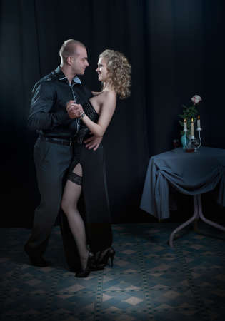 man in love with a girl dancing photo