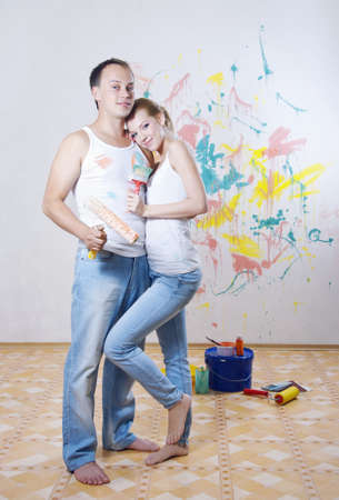 Young couple in love make repairs  photo