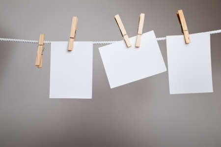 White paper cards on clothes-pegs