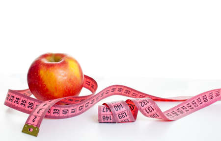 metre: apple with metre on a white background Stock Photo