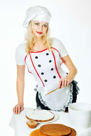 female chef: woman chef is preparing a cake