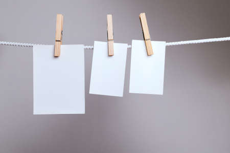 clothespegs: White paper cards on clothes-pegs  Stock Photo