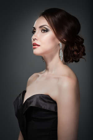 Woman in evening dress with bright makeup photo