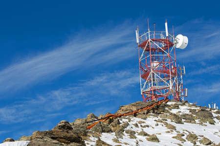 Cellular antenna on top of the mountain photo