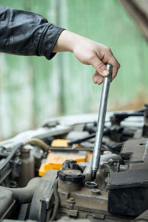 Replacement tip spark plugs, car repair