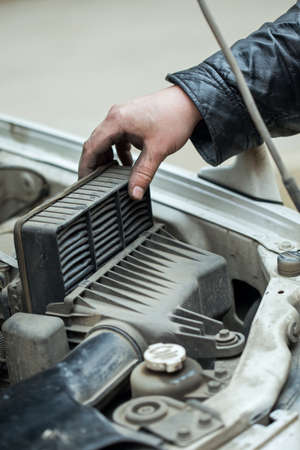 replacing the air filter, car repair  photo