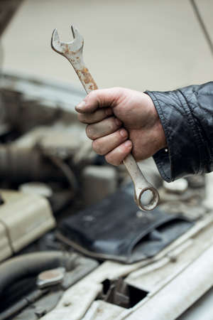 wrench in hand, car repair  photo