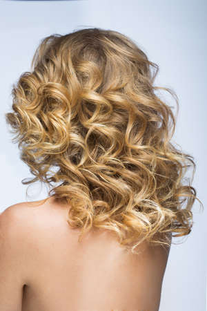 Beautiful blond girl with fluffy hair  photo