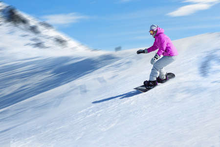 Snowboarder at a ski resort in the mountains  Foto de archivo