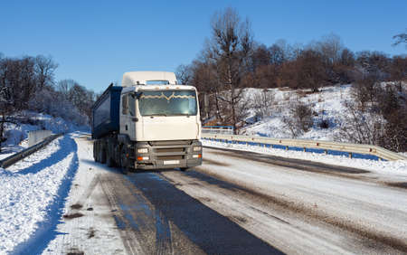 truck on a winter road  photo