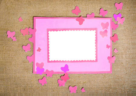 Frame made ​​of paper with butterflies photo
