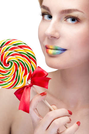 woman with bright makeup and candy  photo