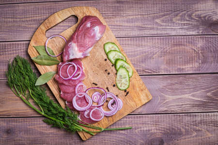 Sliced ​​raw meat pork on board photo
