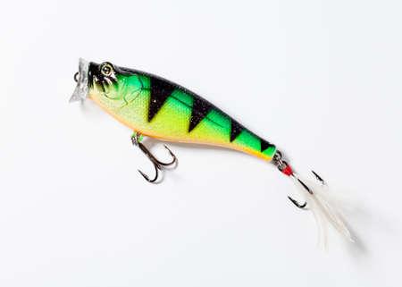 plastic fishing lure, popper, white background photo